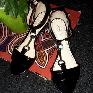Beautiful silver buckle Coach sandals.